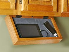Phone-charging Station. If your kitchen counter turns into a rat's nest of charging cords for your family's cell phones, MP3 players, and tablet computers every night, then you need this discreet under-cabinet electronics valet. It mounts easily beneath a kitchen cabinet, hinges down for access, and includes a tip for creating a one-cord solution for charging multiple devices.