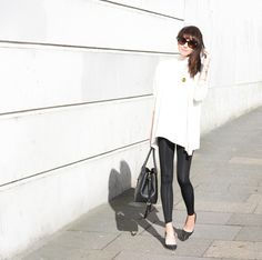 Lorna Luxe: oversized white top, black leggings and the Radial statement gold cuff