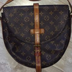 VIntage LOUIS VUITTON CHANTILLY BAG France VI882 VIntage LOUIS VUITTON CHANTILLY BAG France 1980's VI882  PReOwned  No dust bag  Leather nice honey color   Snap to secure buckle to bag is broken . Repairable .  BAG STILL BUCKLES CLOSED  Brass needs a cleaning   Inner zipper pocket powdery   Piping is excellent   CrossBody strap is adjustable   DATE code VI 882 Louis Vuitton Bags Crossbody Bags