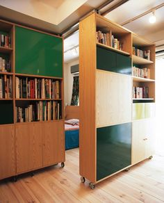 bookshelves on castors and rails... could this be useful in a home?