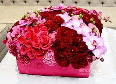 Empty Vase Florist / Love Box Mix  Description:A vibrant combination of Red South America Roses, Stems of Phalaenopsis Orchids and Hydr...