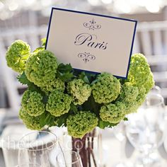Green Floral Centerpieces and Blue card with Table numbers