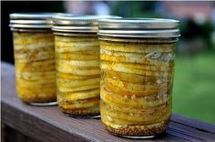Squash Pickles...bring sugar, vinegar and spices (mustard seeds, dill, red pepper flakes) to a boil. Pour over sliced squash and let sit for 48 hours in the fridge. Yum!