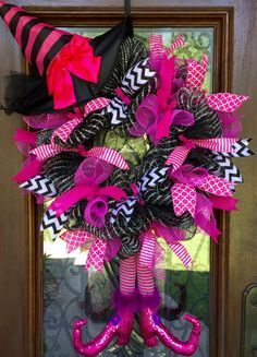 Pink witches hat and legs wreath for Halloween   www.facebook.com/southernsass