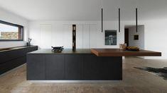La cucina si presenta come un'armoniosa composizione di tre volumi su concept T45.