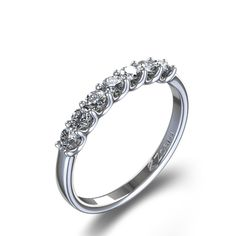 Rock and roll with a 3/8 ctw Round Cut Delicate Diamond Wedding Ring