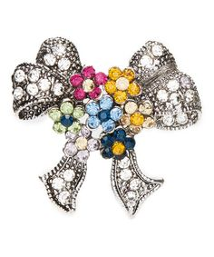Prismatic rhinestones create gorgeous flower on this brooch to punctuate your look with sparkling style.