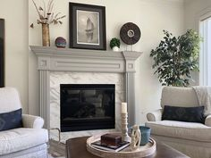 Check out these 5 fireplace transformations that used minimal remodeling to make a big impact. Painted Fireplace Mantels, Painted Mantle, Wood Mantels, Fireplace Remodel, Fireplace Redo, Grey Fireplace, Iridescent Tile, Marble Look Tile, Grey Paint