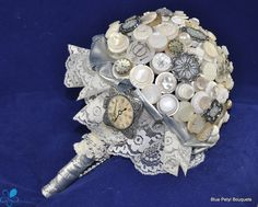 jsut the idea of using some old buttons to accent the bouquet, not a full button boquet...