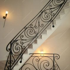 modern stair railing ideas iron safety grill design for staircase Modern Stair Railing, Wrought Iron Stair Railing, Stair Railing Design, Stair Handrail, Staircase Railings, Modern Stairs, Balcony Railing, Stairways, Railing Ideas