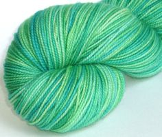 Sock yarn Crystal Clear hand dyed wool 80/20 superwash merino / nylon sock / fingering weight yarn. $20.00, via Etsy.