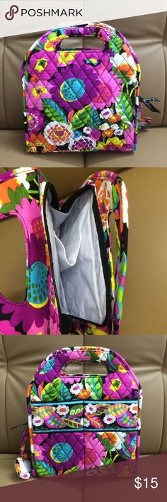 NWOT Vera Bradley Lunch Tote Va Va Bloom My price is final price, please don't make offer New without tag Top handles.  Adjustable divider can be repositioned to accommodate most prepackaged frozen meals, as well as full-sized water bottles.  Two slip pockets on front are ideal for napkins, utensils or small snacks.  Quick-wipe interior lining.  Zip-top closure. Vera Bradley Bags