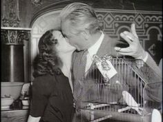 Victor Fleming and Vivien Leigh at GWTW wrap party, where Leigh gifted Fleming with a pair of lovebirds. :-)  Awwww!