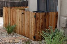 Short wood privacy fence used to hide utility units. #TopekaLandscape