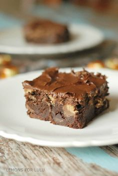 These chocolate peanut butter brownies are sinfully decadent. Lots of rich chocolate, peanut butter and peanut butter cups are crammed into these brownies. A thick and creamy chocolate frosting is layered on top!