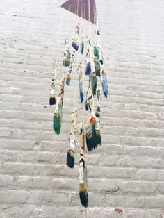 OK - so I LOVE this idea for my art room!!!  Make a Hanging Mobile from Paintbrushes