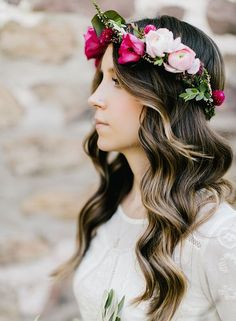 Do curls ever go out of style? We didn't think so. Add to that a trendy flower crown and you have the most romantic and bohemian-inspired look for your walk down the aisle. Photo by Emily Wren