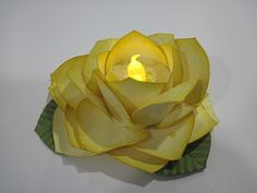 I have seen several of these roses made with the Ornament Punch. They are all absolutely beautiful! But when I saw the one that Kathy Braun. Tea Light Candles, Tea Lights, Battery Lights, Beaded Flowers, Diy Flowers, Banquet Centerpieces, Beauty And The Beast Party, Candle Craft, Flower Lights