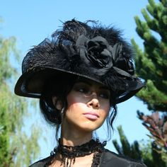 Price: $129.95  Perfect hat for your Victorian and Edwardian fashions - very dramatic! Black roses with plumes on a wide brim.
