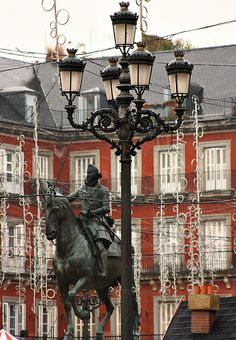 Felipe III in the Plaza Mayor. Madrid. A much loved leader who guided Spain's fortunes well and belovedly known as 'big nose'. Seen here amongst the Christmas lights.
