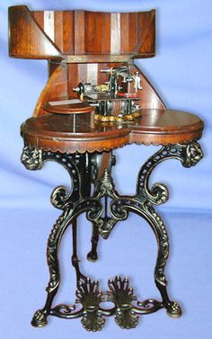 Produced by The Britannia Sewing machine Company, Colchester, England, this highly ornate treadle is one of the UK's most collectable combinations. The machine head is based on the commonly copied Wheeler Wilson rotary shuttle type. This model was manufactured for several years from the late 1860s.  collection - London Sewing Machine Museum