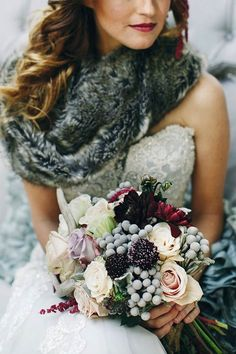 photo: Photography By Charise via Wedding Chicks; winter wedding bridal bouquet idea