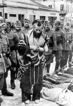 """The man in the much publicized Holocaust photo has been only recently identified as Rabbi Moshe Hegerman, the Rabbi of Olkusz in Poland. Brought to the town square for execution he asked to let him say first Kaddish for his slain brethren. The soldiers laughed while watching him praying and then killed him."""