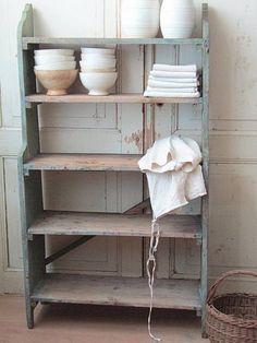 Old shelf with a beautiful, worn, light blue finish.