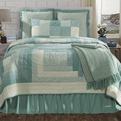 <p> The Sea Glass Bedding is a coastal modern interpretation of a classic quilt .This quilt features a block patchwork pattern in a variety of mini floral and ditzy prints in white and teal colored (aqua) fabrics. The quilt is bordered in lime green. On the back of the quilt is a solid cream. It is a 100% cotton shell and is hand quilted with stitch in%...