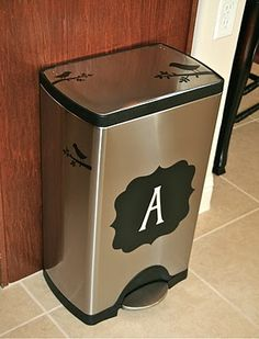 embellish trash can with cricut machine and vinyl.