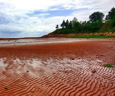 Thunder Cove, Prince Edward Island Prince Edward Island has more than 500 miles of beaches, and about half have red sand due to high iron oxide content. The southern coast, where many such beaches are located, is known as Red Sands Shore jane Green Sand Beach, Red Beach, Boulder Beach, Prince Edward Island, All Inclusive Resorts, Travel And Leisure, Beach Trip, Places To See, Scenery