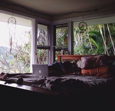 What a dream room, look at those huge windows! Looks like it's on the beach, up high, in woodsy jungly beautiful place.