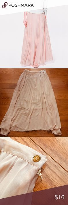 Pleated Maxi Skirt Pretty and trendy maxi skirt by Haoduoyi.  • Creamy blush color • Pleated Chiffon fabric • Shorter, non see-through underskirt/lining • Side zipper and gold button closure • Asymmetrical hem  Re-Posh; I bought this NWT and unfortunately only ever wore it once for a few hours - Other than a small hole in the underlining, it still looks new! Would keep it, but I just haven't had enough occasions to wear it :-(  My loss = your gain! Haoduoyi Skirts Maxi