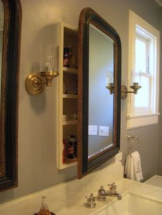Restoration Hardware mirrors over medicine cabinets - LOVE this idea, or you could use a pair of vintage mirrors