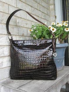 BRIGHTON CHER BRONZE HANDBAG... Mine is pewter but I wish I had one in EVERY color!!!!!