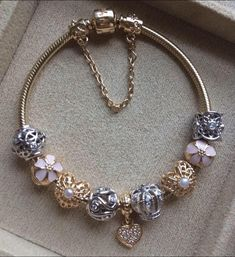 PANDORA Bracelet with Stunning Gold Charms and a Touch of Pink.