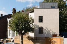 This wonderfully engaging detached contemporary house is arranged over four storeys, with a double-height living space, four double bedrooms and three bathrooms. The house occupies a wedge-shaped site that previously contained a small workshop, and has been partly sunk into the ground in order to maximise the size. It is entered on the half level, […]