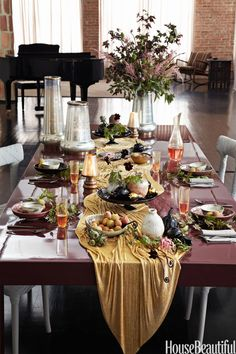 "Add shimmer to your fall tablescape. Designer Laura Kirar sets a glossy table for a dinner party. ""I kept high objects on one end and draped the gold mesh runner down the center, creating the effect of a waterfall,"" she says."