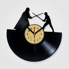 Hang this Star Wars vinyl record clock over your desk.