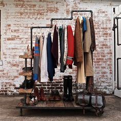 Garment rack with upcycled pallet board base, metal pipes, and salvaged wood shelves. Lots more creative pallet ideas at http://pinterest.com/wineinajug/passion-for-pallets/