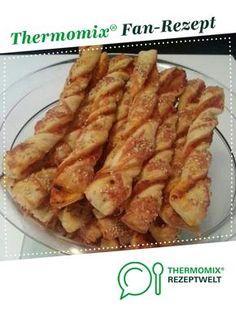 Melli's Pizzastangen Salami-Schinken mit Käse-Sesam-Kruste von Zahnfee1989. Ein Thermomix ® Rezept aus der Kategorie Backen herzhaft auf www.rezeptwelt.de, der Thermomix ® Community.