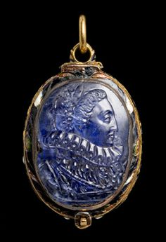 The oval gold locket enameled with black and white pea-pod ornament at the sides is mounted on the lid with a sapphire cameo portrait of Queen Elizabeth I (1533-1603) and with an onyx cameo bust of Cleopatra with the asp on the back. Inside there is an enameled miniature of Charles I (1600-1648) facing front with a melancholy expression, wearing sash of the Order head standing out against a celestial blue ground. Locket: early 17th century, Cameo: second half of the 16th century.
