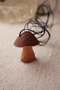 carved avocado seed necklace mushroom