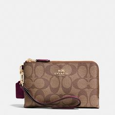 "Coach Double Corner Zip Signature Wristlet Signature Coated Canvas.  6 1/4 * 4"".  Zip Closure.  Fabric lining.  Authentic.  Wrist strap attached. Coach Bags Clutches & Wristlets"