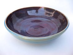 Wheel-thrown bowl glazed inside with blue / plum and outside with blue opal on white stoneware