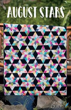 August Stars By Herman, Julie  - Create dazzling stars to light up the room like an August sky at night. Use an assortment of 2 1/2 Strips in solids, blenders, batiks or small scale prints with a high contrast background fabric to create a quilt that sparkles - with no Y seams! -- 5 Sizes - Baby 41 x 48 ? Youth - 49 x 60 - Lap 55 x 72 ? Twin 69 x 84 ? Queen 97 x 96 - Uses JBQ202 or JBQ204.
