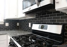 black-slate-backsplash-tile-white-cabinet
