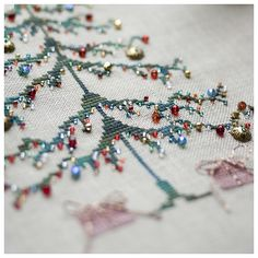 """Love this idea of simple cross stitch tree """"decorated"""" with """"ornaments"""" = bead & charms treasures from your stash. Pattern is in the book """"Stitch"""" by Penny Black Ribbon Embroidery, Cross Stitch Embroidery, Embroidery Patterns, Cross Stitch Patterns, Cross Stitch Tree, Simple Cross Stitch, Christmas Embroidery, Christmas Cross, Winter Christmas"""
