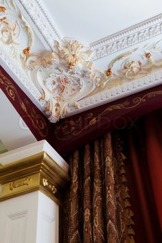 Image of 'stucco on the ceiling and curtains in rich apartment'
