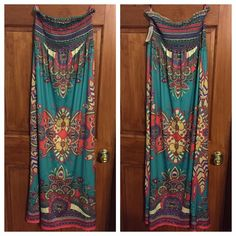 Beautiful boho chic print smocked maxi dress NWT Super comfy turquoise, coral, yellow, purple, boho chic printed maxi dress. Smocked top with flowy floor length skirt. Brand new with tags never worn. 90% polyester, 10% spandex. Forever 21 Dresses Maxi